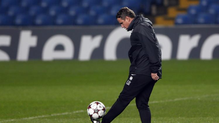 Steaua Bucharest's coach Reghecampf controls a ball during a team training session at Stamford Bridge in London