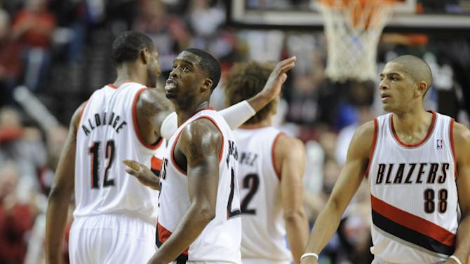 Portland Trail Blazers' Wesley Matthews, center, celebrates a three point shot during the second half of an NBA basketball game against the Houston Rockets in Portland, Ore.,Thursday Dec. 12, 2013. Portland beat the Rockets 111-104. (AP Photo/Greg Wahl-Stephens)