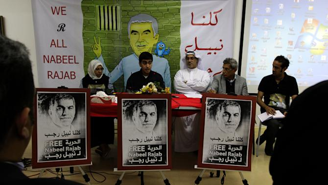 Adam Rajab, second left, the son of jailed human rights activist Nabeel Rajab, speaks during a press conference Saturday, Aug. 18, 2012, in Manama, Bahrain, about the three-year sentence imposed on his father. Speakers, left to right, are lawyer Jalila al-Sayyed, Adam Rajab, lawyer Mohammed al-Tajer, and human rights activists Abdelnabi al-Ekri and Sayyed Yousif al-Muhafdha. They urged the international community pressure the Bahraini government to free him. (AP Photo/Hasan Jamali)