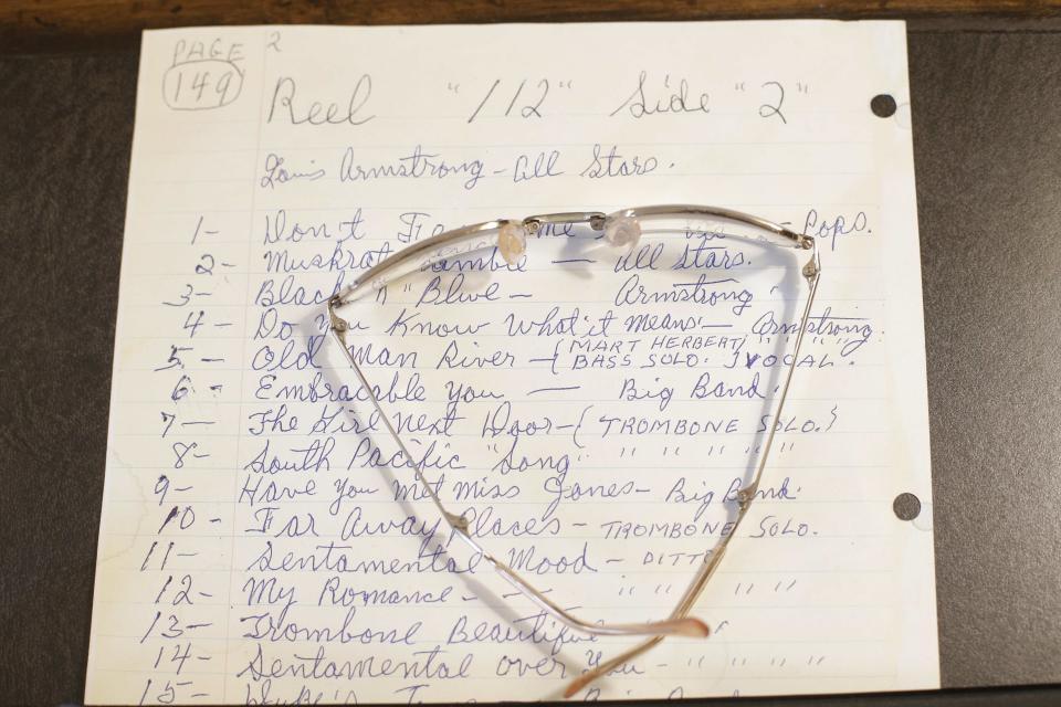 A written note and eyeglasses belonging to Louis Armstrong on display at the Louis Armstrong House Museum Wednesday, Oct. 9, 2013, in the Queens borough of New York. (AP Photo/Frank Franklin II)