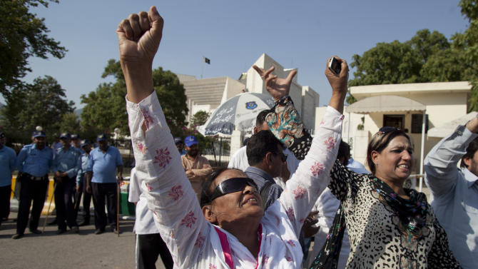 Supporters of the ruling Pakistan People's Party react over the Supreme Court's decision against Pakistan's Prime Minister, Yousuf Reza Gilani, outside the court in Islamabad, Pakistan on Tuesday, June 19, 2012. Gilani has been disqualified from office due to an earlier contempt conviction, the top court declared Tuesday, a ruling that was likely to usher in new political turmoil in the nuclear-armed country. (AP Photo/B.K. Bangash)