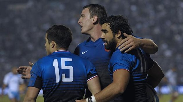 France's wing Yoann Huget (R) is embraced by teammate number 8 Louis Picamoles (C) and fullback Brice Dulin after scoring a try against Argentina's Pumas during their rugby union international test match at Jose Fierro stadium in Tucuman (AFP)