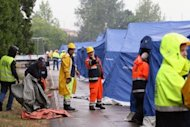 Rescuers build a tent camp in the football stadium of Finale Emila. A powerful earthquake shook Italy's industrial and densely populated northeast early Sunday, killing at least six people, felling homes and factories and toppling church steeples