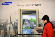 A signboard of Samsung Electronics&#39; smartphone &#39;Galaxy Note&#39; is seen at a showroom of its headquarters in Seoul, in January. Samsung reported a record net profit of 5.05 trillion won ($4.44 bln) in the first quarter, thanks largely to strong smartphone sales