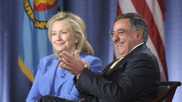 Secretary of State Hillary Rodham Clinton and Defense Secretary Leon Panetta share a laugh during an event at the National Defense University in Washington, Tuesday, Aug. 16, 2011. (AP Photo/Susan Walsh)