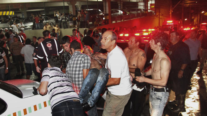A victim of a fire in a club is carried in Santa Maria city, Rio Grande do Sul state,  Brazil,  early Sunday,  Jan. 27,  2013.  According to police more than 200 died in the devastating nightclub fire in southern Brazil.  Officials say the fire broke out at the Kiss club in the city of Santa Maria while a band was performing. At least 200 people were also injured.  (AP Photo/Deivid Dutra/Agencia Freelancer)
