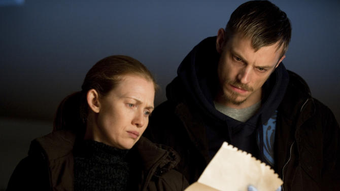 """This image provided by AMC shows Mireille Enos, left, and Joel Kinnaman in a scene from season two of """"The Killing."""" (AP Photo/AMC, Cate Cameron )"""