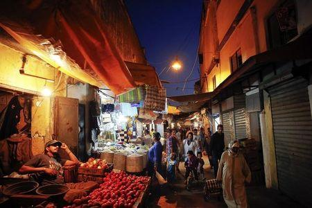 People shop for food in a narrow street of Rabat's Medina