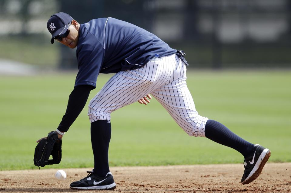 New York Yankees' Alex Rodriguez fields a grounder during practice at baseball spring training, Saturday, Feb. 25, 2012, in Tampa, Fla. (AP Photo/Matt Slocum)