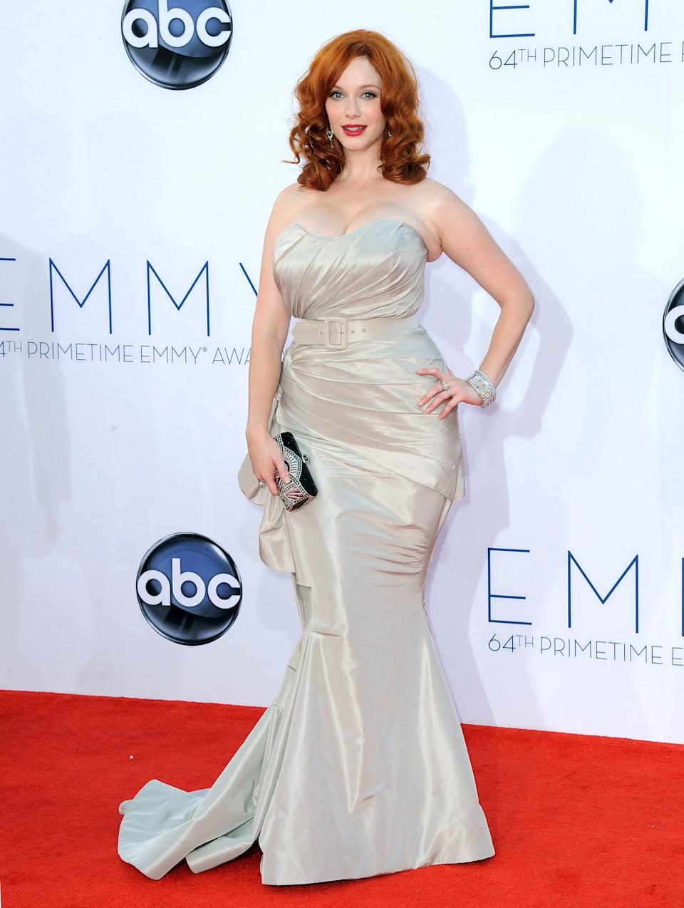 Actress Christina Hendricks arrives at the 64th Primetime Emmy Awards at the Nokia Theatre on Sunday, Sept. 23, 2012, in Los Angeles.  (Photo by Jordan Strauss/Invision/AP)