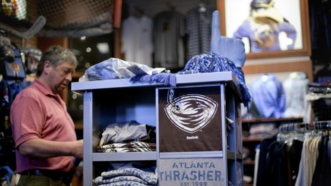 Tony Tlusty, of Prague, Czech Republic, shops in the team store in Philip's Arena, home of the Atlanta Thrashers NHL hockey team Friday, May 20, 2011 in Atlanta. According to reports in Atlanta and Winnipeg, Thrashers owners are in negotiations with True North Sports and Entertainment, which would relocate the team to Winnipeg. (AP Photo/David Goldman)