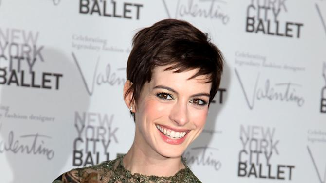 "This Sept. 20, 2012 photo released by Starpix shows actress Anne Hathaway arrives at the New York City Ballet Fall Gala honoring fashion designer Valentino Garavani at Lincoln Center in New York. Hathaway will perform songs from the musical ""Caberet"" for a one-night only appearance titled, ""Perfectly Marvelous: The Songs of Cabaret with Anne Hathaway and Friends,"" on Wednesday, Oct. 24 at 7 p.m. at Joe's Pub in New York to support The Public Theater's revitalization of its downtown home at Astor Place. (AP Photo/Starpix, Amanda Schwab, file)"