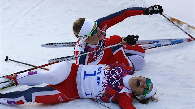 Winner Maiken Caspersen Falla (front) of Norway and her team mate, second placed Ingvild Flugstad Oestberg celebrate after competing in the women's cross-country sprint free final at the Sochi 2014 Winter Olympic Games in Rosa Khutor (Reuters)
