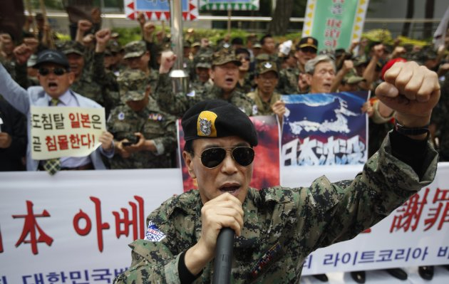 War veterans chant slogans during an anti-Japan rally in front of Japanese embassy in Seoul