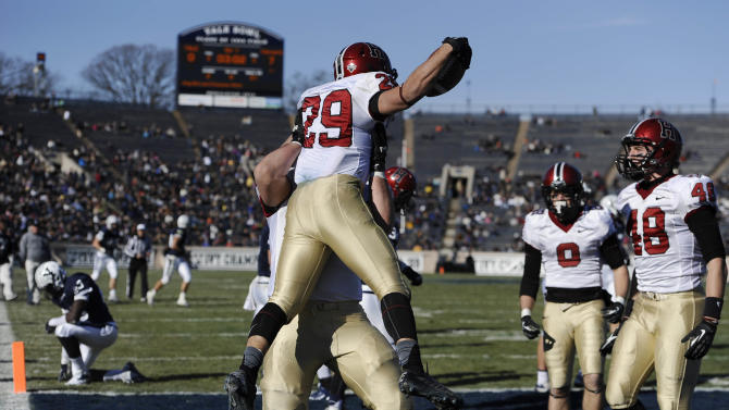 Harvard beats Yale 34-7, 7th straight in The Game