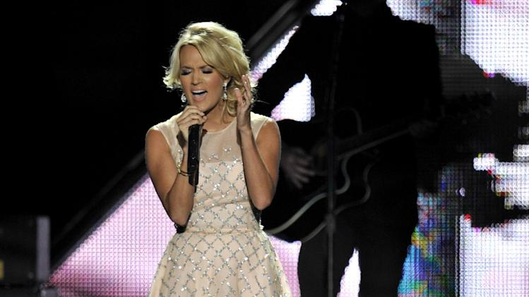Carrie Underwood performs at the 2013 CMT Music Awards at Bridgestone Arena on Wednesday, June 5, 2013, in Nashville, Tenn. (Photo by Donn Jones/Invision/AP)