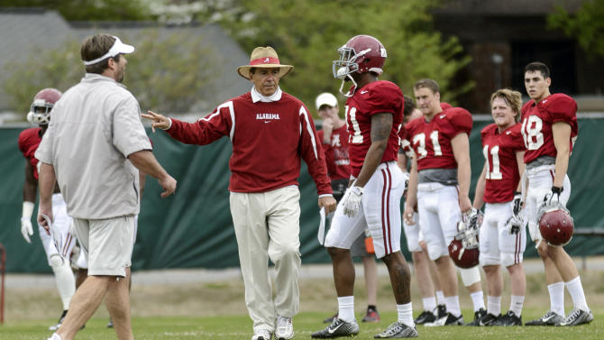Alabama head coach Nick Saban gives feedback during an NCAA college spring football practice, Monday, April 7, 2014, in Tuscaloosa, Ala
