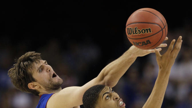 Kansas' Jeff Withey fights for a loose ball with Kentucky's Anthony Davis, right, during the first half of the NCAA Final Four tournament college basketball championship game Monday, April 2, 2012, in New Orleans. (AP Photo/Mark Humphrey)