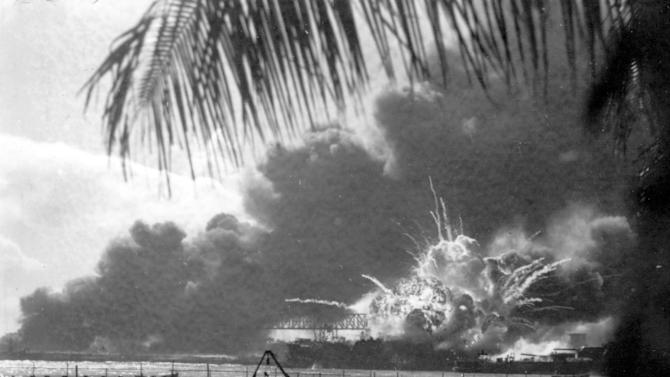 FILE - In this Dec. 7, 1941 file photo, the destroyer USS Shaw explodes after being hit during the Japanese surprise attack on Pearl Harbor, Hawaii. (AP Photo)