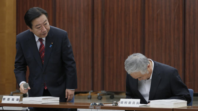 Japanese Prime Minister Yoshihiko Noda, left, greets Yotaro Hatamura, chairperson of the Investigation Committee on the Accident at the Fukushima Dai-ichi Nuclear Power Station of Tokyo Electric Power Co. before speaking to the committee meeting in Tokyo Monday, July 23, 2012. Experts, led by Hatamura, investigating Japan's nuclear disaster said Monday that the operator of the crippled plant continues to drag its feet in investigations and has tried to understate the true amount of damage at the complex. The report, by the government-appointed panel, is the latest of several to fault TEPCO and the government for doing too little to protect the Fukushima plant from the massive earthquake and tsunami that set off three meltdowns there in the world's worst nuclear accident since Chernobyl. (AP Photo/Shizuo Kambayashi)