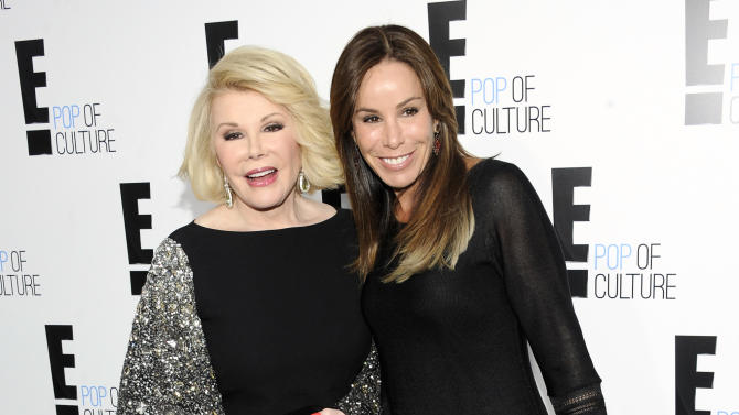 """FILE - This April 30, 2012 file photo shows comedian and TV host Joan Rivers from the show """"Fashion Police"""" and her daughter Melissa Rivers at an E! Network upfront event in New York. Joan Rivers turned 80, a milestone that has prompted the E! network to celebrate. Its regular one-hour edition of """"Fashion Police"""" will be a black-tie birthday salute, preceded nightly through Thursday by special half-hours featuring guest appearances by celebrities and even victims of past fashion slams. (AP Photo/Evan Agostini, file)"""