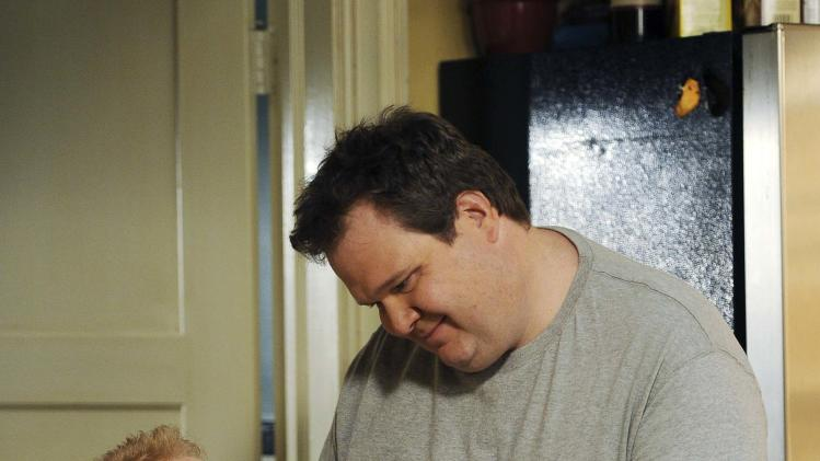 "In this publicity image released by ABC, Jesse Tyler Ferguson portrays Mitchell Pritchett, left, and Eric Stonestreet portrays Cameron Tucker in a scene from the comedy series ""Modern Family."" The 63rd Emmy Award nomination announcements will be made on Thursday, July 14, 2011. (AP Photo/ABC, Mitch Haddad)"
