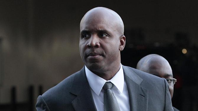 Bonds pays $4,100 stemming from conviction