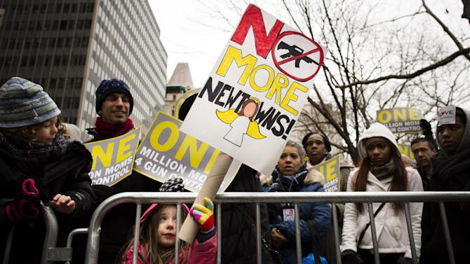 """FILE - In this Jan. 21, 2013 photo, Emma Clyman, 5, of Manhattan, holds a sign that reads """"No More Newtowns"""" outside city hall park during the One Million Moms for Gun Control Rally in New York. Despite a proposal backed by over 8 in 10 people in polls, gun control supporters are struggling to win over moderate Democrats in their drive to push expanded background checks of firearms purchasers through the Senate next month. (AP Photo/John Minchillo, File)"""