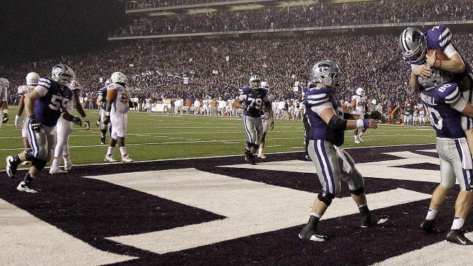 Kansas State quarterback Collin Klein (7) celebrates with tight end Travis Tannahill (80) after Klein scored a touchdown during the second half of an NCAA college football game against Texas Saturday, Dec. 1, 2012, in Manhattan, Kan. Kansas State won the game 42-24. (AP Photo/Charlie Riedel)