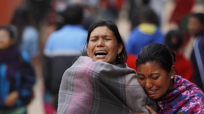 Family members break down during the cremation of an earthquake victim inBhaktapur near Kathmandu, Nepal, Sunday, April 26, 2015. A strong magnitude 7.8 earthquake shook Nepal's capital and the densely populated Kathmandu Valley before noon Saturday, causing extensive damage with toppled walls and collapsed buildings, officials said. (AP Photo/Niranjan Shrestha)