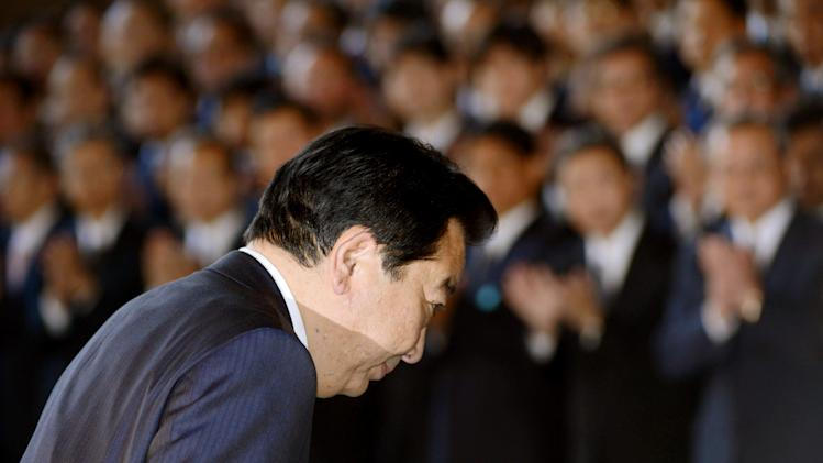 Japan's Prime Minister Yoshihiko Noda bows as he leaves the prime minister's office in Tokyo, Wednesday, Dec. 26, 2012.  Prime Minister Noda's Cabinet resigned Wednesday to clear the way for a vote in parliament to formally install the nation's new leader, Shinzo Abe, a conservative whose nationalist positions have in the past angered Japan's neighbors. (AP Photo/Kyodo News) JAPAN OUT, MANDATORY CREDIT, NO LICENSING IN CHINA, HONG KONG, JAPAN, SOUTH KOREA AND FRANCE