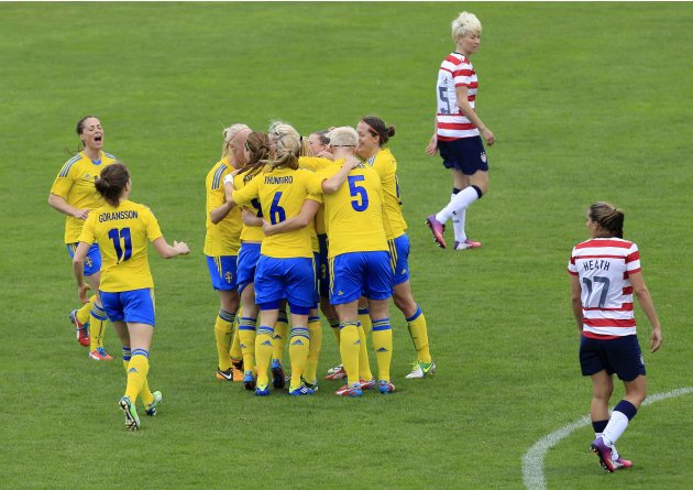 Sweden's players celebrate goal against the U.S. during women's Algarve Cup soccer match at Lagos city stadium in southern Portugal
