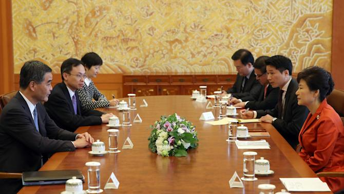 Hong Kong Chief Executive Leung Chun-ying talks with South Korean President Park Geun-hye during their meeting at the Presidential Blue House in Seoul