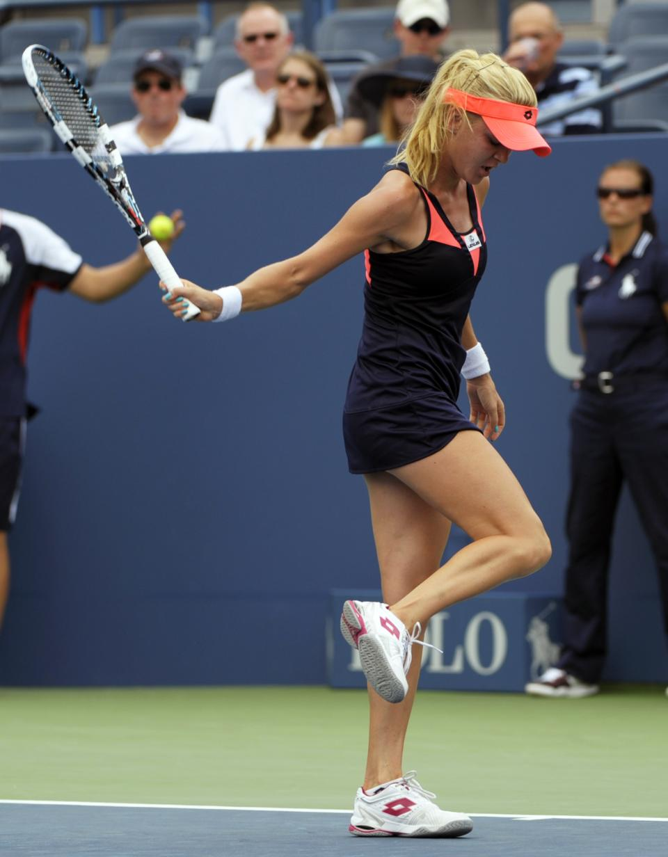 Poland's Agnieszka Radwanska reacts during a second round match against Maria-Teresa Torro-Flor, of Spain, at the 2013 U.S. Open tennis tournament, Wednesday, Aug. 28, 2013, in New York. (AP Photo/Kathy Kmonicek)