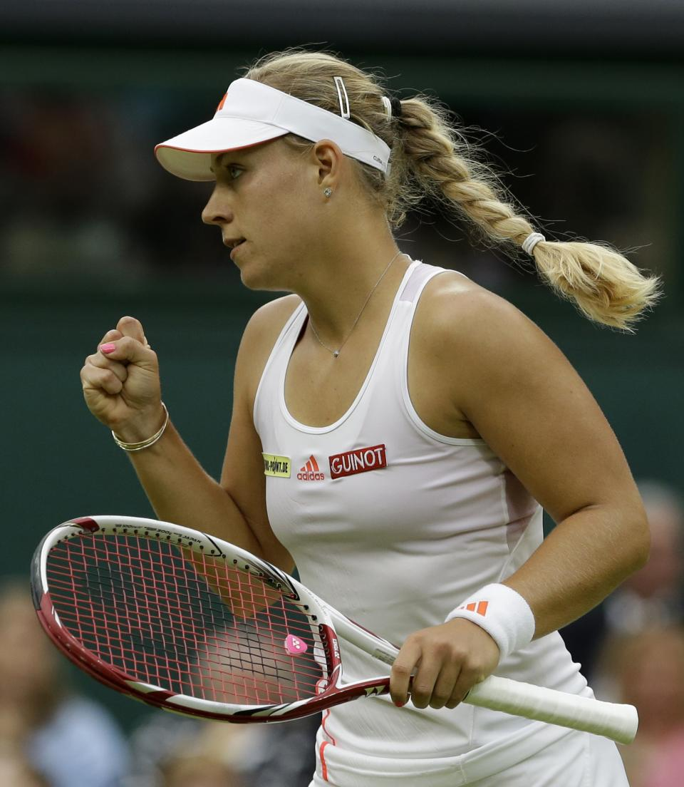 Angelique Kerber of Germany reacts during a quarterfinals match against Sabine Lisicki of Germany at the All England Lawn Tennis Championships at Wimbledon, England, Tuesday, July 3, 2012. (AP Photo/Anja Niedringhaus)