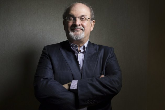 "FILE - This Sept. 8, 2012 file photo shows author Salman Rushdie posing for a photo as he promotes the movie ""Midnight's Children"" during the 2012 Toronto International Film Festival in Toronto. Rushd"