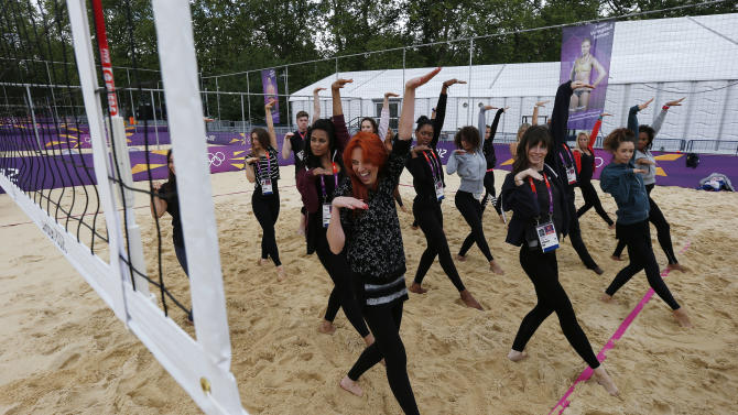 Dancers rehearse at the London 2012 Olympics beach volleyball venue in central London