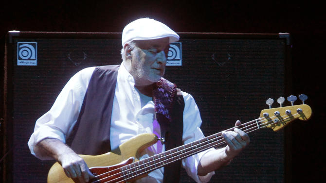 FILE - This April 8, 2013 file photo shows bassist John McVie performing during a Fleetwood Mac concert at Madison Square Garden in New York. The New Orleans Jazz and Heritage festival begins Friday, April 25. This year's headliners are big, including Billy Joel, Fleetwood Mac, Hall and Oates, The Black Keys, Maroon 5, Jill Scott, Kem, Frank Ocean and the Dave Matthews Band.  (Photo by Jason DeCrow/Invision/AP, file)