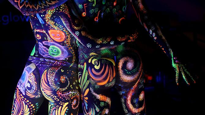 Models display ultraviolet light paint during the annual World Bodypainting Festival in Poertschach
