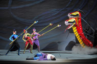 In this June 10, 2012 handout photo provided by the San Francisco Opera, Rene Tatum, Lauren McNeese and Melody Moore as The Three Ladies and Alek Shrader as Tamino, are shown during a scene from the final dress rehearsal of &quot;The Magic Flute.&quot; The San Francisco Opera&#39;s summer season includes a musically rousing rendition of Verdi&#39;s Attila, and a visually captivating take on Mozart&#39;s The Magic Flute. (AP Photo/San Francisco Opera, Cory Weaver)