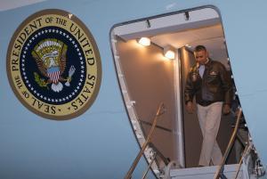 President Barack Obama steps off Air Force One after…