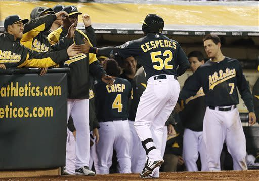 Lowrie powers A's past Mariners 6-2