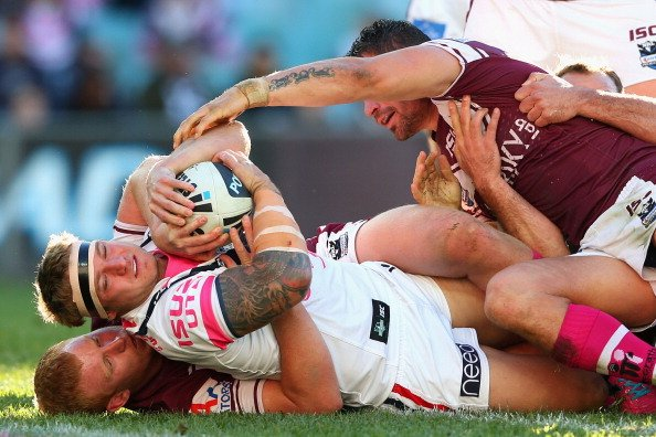 Jake Friend of the Roosters is held up over the tryline during the round 16 NRL match between the Sydney Roosters and the Manly Sea Eagles at Allianz Stadium on June 24, 2012 in Sydney, Australia. (Ph