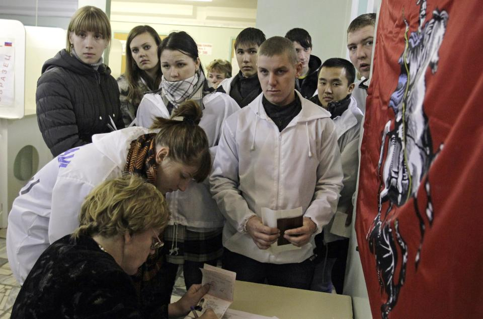 Members of the pro-Kremlin Nashi movement from other cities get their ballots at a polling station in Moscow, Sunday, Dec. 4, 2011.  Russians cast their ballots with muted enthusiasm in national parliament elections on Sunday, a vote that opinion polls indicate could water down the strength of the country's dominant party.(AP Photo/Sergey Ponomarev)