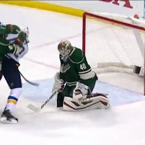 Backes jams puck past Dubnyk