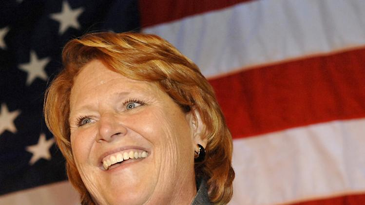 FILE - In this Nov. 6, 2012 file photo, Sen.-elect Heidi Heitkamp, D-N.D., address her supporters in Bismarck, N.D. (AP Photo/Will Kincaid, File)