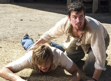 Taylor Handley and Matthew Bomer in New Line's Texas Chainsaw Massacre: The Beginning