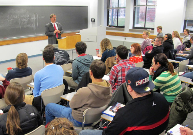 In this Nov. 27, 2012 photo Marquette University professor Tim Machan teaches a class on J.R.R. Tolkien that focuses on all of his books, books that influenced Tolkien and other tidbits about the writ