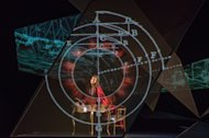 "This July 18, 2012 photo released by the Lincoln Center Festival shows Elizabeth Futral performing a scene from the opera ""Emilie,"" presented by Lincoln Center Festival 2012 at the Gerald W. Lynch Theater at John Jay College in New York. (AP Photo/Lincoln Center Theater, Stephanie Berger)"