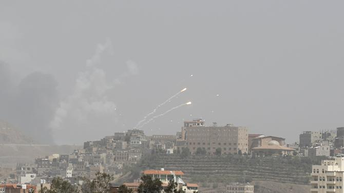 Rockets fly from a missile base which was hit by an air strike in Yemen's capital Sanaa